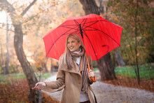 Happy Young Woman Enjoy In Autumn Rain