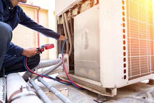 Technician is checking air conditioner ,measuring equipment for filling air conditioners Canvas Print
