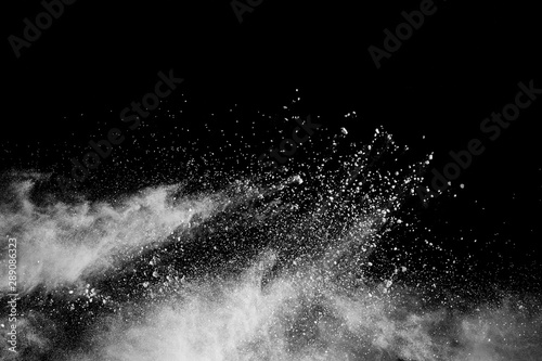 White powder explosion isolated on black background. White dust particles splash. - 289086323