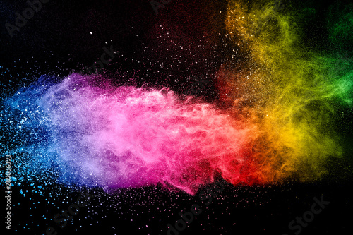 Fotobehang Heelal Abstract multicolored powder explosion on black background. Color dust particle splattered on background.