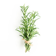 Green Bundle Of Rosemary Isolated On A White Background. Мedicinal Herbs. Flat Lay. Top View