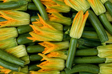 Basket Of Small Zucchini Or Courgette, Green, Full Of Edible Flowers, Yellow And Orange, At Local Vegetable Market, Agriculture, Food, Farm, Diet, Vitamins, Nutrition, Summer, Background, Milan, Italy