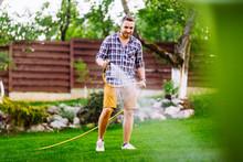 Caucasian Man Working On Grass...