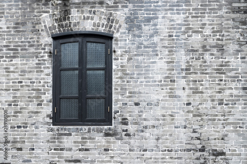 Foto auf AluDibond Shanghai Traditional classic wood window and brick wall in ancient chinese house, shanghai city, china