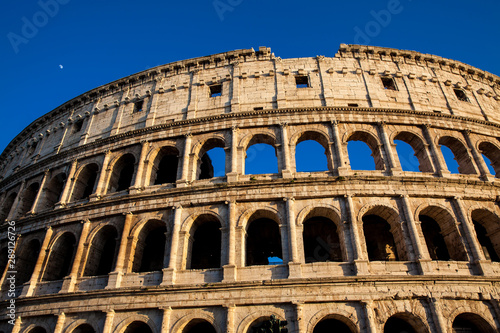 Fototapeta  The famous Colosseum under the beautiful light of the golden hour in Rome