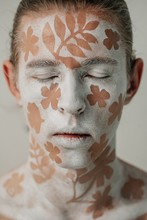 Portrait Of A Redhead Mime Artist With A Floral Design On His Face