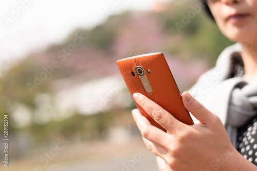 Obraz na plátne  Asian woman using mobile phon