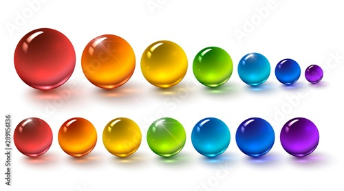 Fotografie, Obraz Set of multi-colored glass balls on a white background, round drops of rainbow c