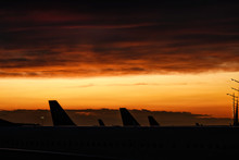 Tails Of Airplanes At Airport During Boarding Operations