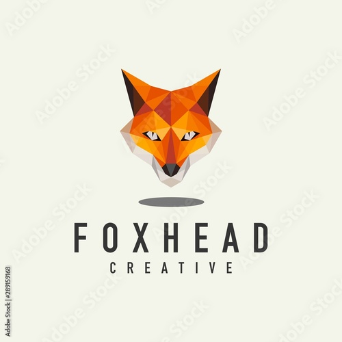 Photo  geometric fox head logo - vector illustration on a light background