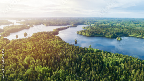 Lake system surrounded with green forest in Finland, aerial landscape Fotobehang