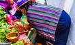 Leinwanddruck Bild Maya woman on market in Chichicastenango in Guatemala