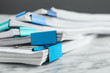 canvas print picture - Stack of documents with binder clips on marble table, closeup