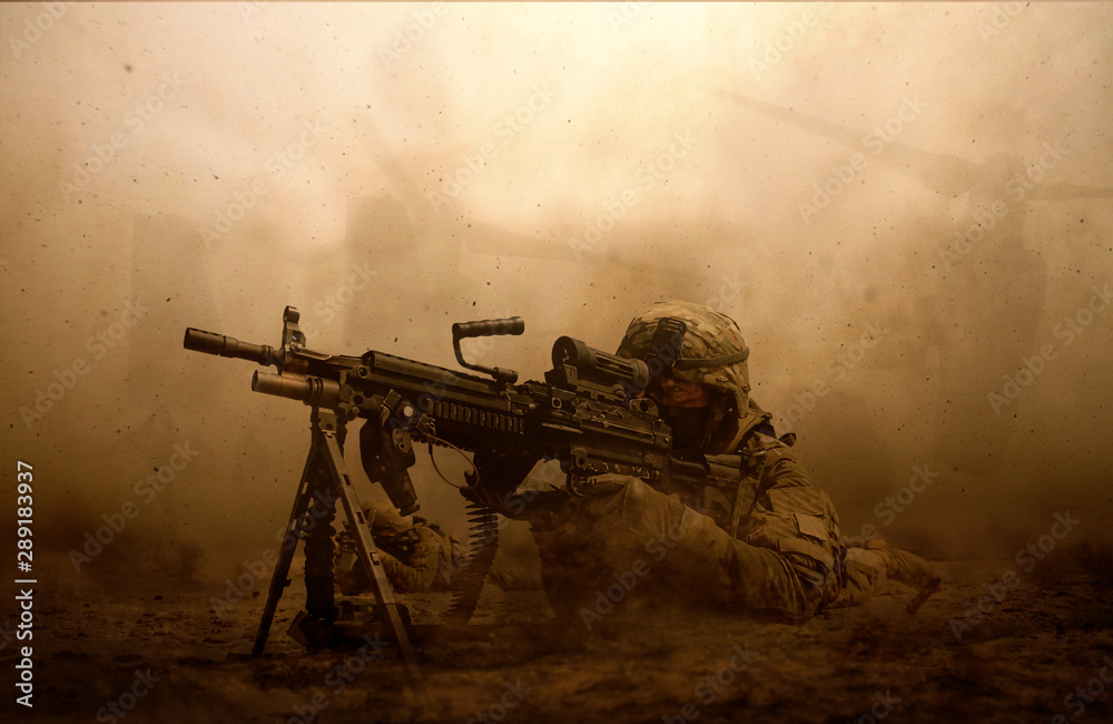 Fototapeta Military troops and helicopter in the battlefield / Soldier shooting at the enemy