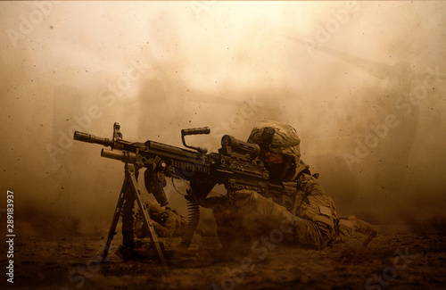 Fotografiet  Military troops and helicopter in the battlefield / Soldier shooting at the enem