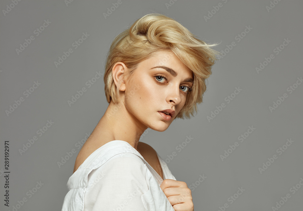 Fototapeta Portrait of young woman with blond short hair