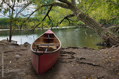 Red Canoe rests on the shore at the Lynde Shores Conservation park фототапет
