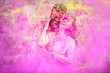 canvas print picture - Happy fun loving asian indian couple painted in colors celebrating holi festival outdoor, love and relationship