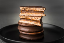 Alfajor With Dulce De Leche Sweet Pastry Cake, A Traditional Argentine Dessert With Chocolate And Caramel