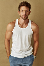 Handsome Man In Tank Top Wearing Glasses