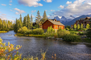 Spring Creek Alpine Village Landscape with Distant Three Sisters Mountain in Town of Canmore, Alberta Foothills of Canadian Rockies