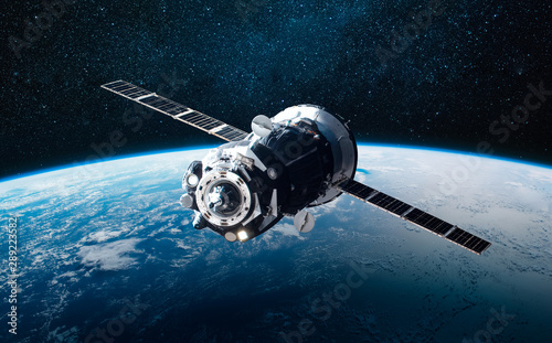 Obraz Cargo space ship on orbit of the Earth planet. Milky way on background. Elements of this image furnished by NASA - fototapety do salonu