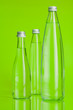 Leinwanddruck Bild - Clear and pure mineral water on a bright green background