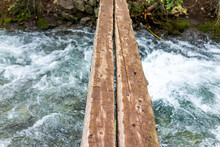 Mountain River Stream Looking Down In Rocky Mountains In Summer Of 2019 On Conundrum Creek Trail In Aspen, Colorado With Wooden Bridge