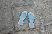 Flip Flop On Concrete Floor