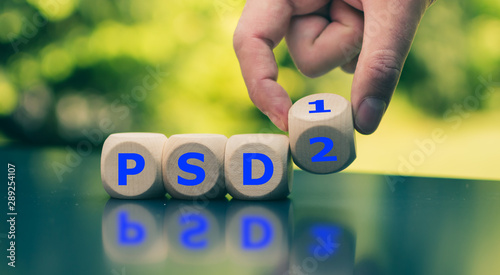 """Hand flips a cube and changes the abbreviation """"PSD!"""" to """"PSD2""""."""