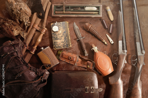 Photo sur Aluminium Chasse Hunting concept with woodcock, shotgun, knife and ammunition for hunting arranged on brown background.
