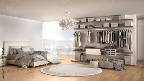 Fotografía  Luxury white modern bedroom with double bed and walk-in closet with clothing, pa