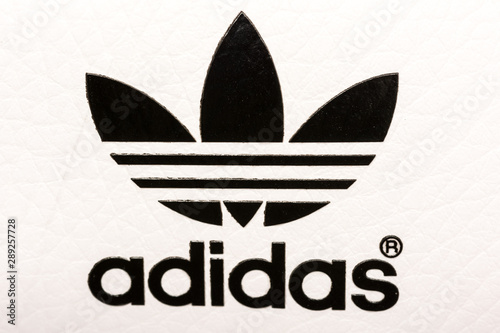 cinta Indígena Alerta  BUCHAREST, ROMANIA - JULY 23, 2014: Adidas Sign On Adidas Sport Shoes.  Founded in 1924 is a German multinational corporation that designs and  manufactures sports shoes, clothing and accessories. - Buy this