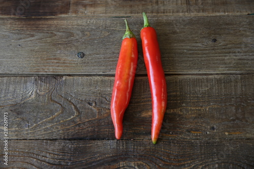 Garden Poster Hot chili peppers organic red hot chili peppers on wooden rustic table. Isolated. Flat lay. Top view. Natural spice or seasoning for health. With copy space for text. Poster, pattern, background, texture, postcard.