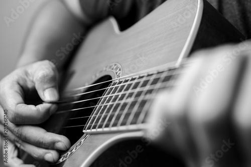 Obraz na plátně  Musicians are playing acoustic guitar.