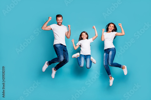 Obraz Full length body size photo of funny funky trendy lucky fortunate family triumphing while isolated with blue background - fototapety do salonu