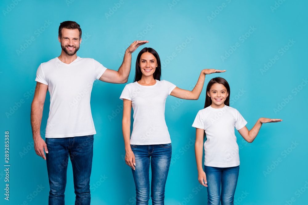 Fototapety, obrazy: Portrait of charming family holding palm wearing white t-shirt denim jeans isolated over blue background
