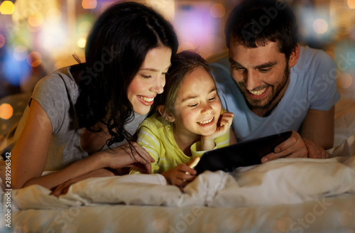 Fotografie, Obraz  people and family concept - happy mother, father and little daughter with tablet