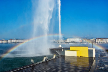 Jet d'Eau water fountain with rainbow, beautiful attraction and symbol of Geneva , Switzerland