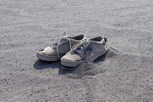 Old Torn White Sneakers On Bla...