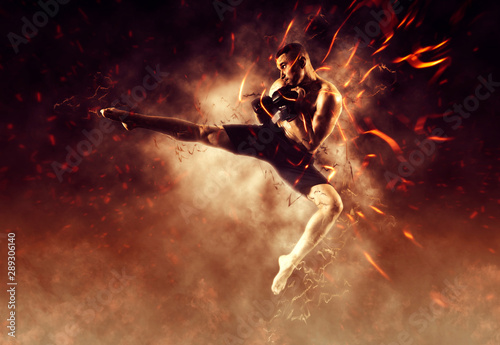 Canvas Print MMA male fighter kick. Flames background
