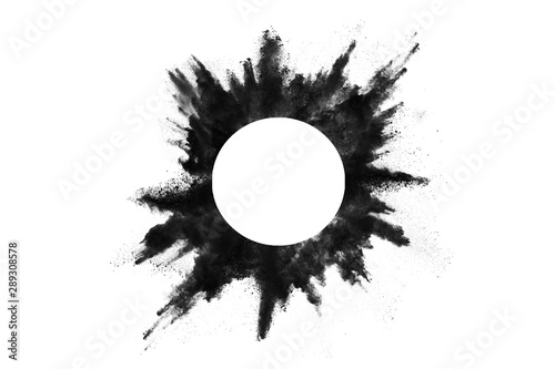 obraz dibond Particles of charcoal on white background,abstract powder splatted on white background,Freeze motion of black powder exploding or throwing black powder.
