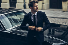 Handsome Man In Black Suit Wit...