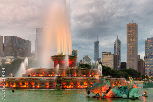 Buckingham fountain and Chicago downtown with skyscrapers at sunset , Chicago, Illinois, USA.