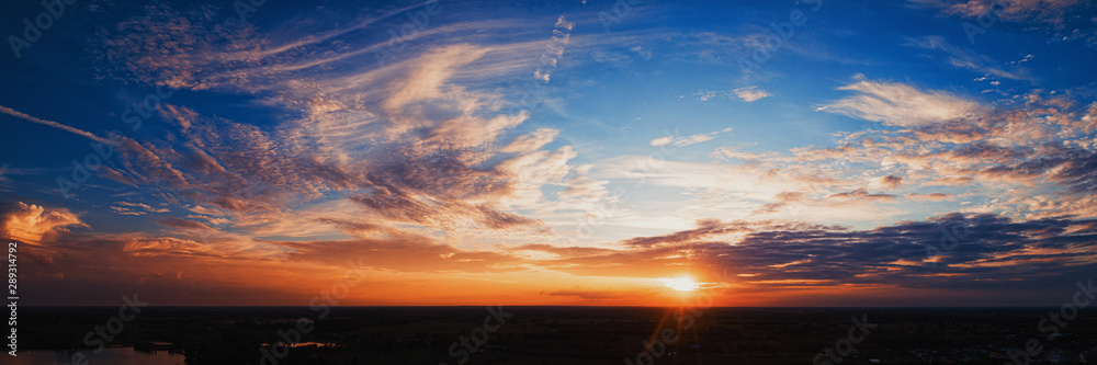 Fototapety, obrazy: Wide panorama of sunset sky with clouds and sunlight over farm