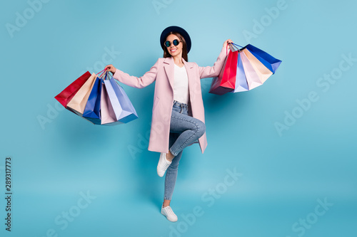 Fototapeta Full body photo of dancing rejoicing girl go shopping buy bargains wear retro pink vintage stylish outfit denim jeans eyewear eyeglasses isolated over blue background obraz