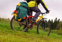Tourist Bike Riding Through The Field, Closeup