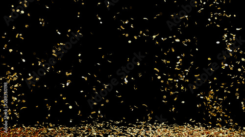 Fotografija  A fountain of golden confetti falling on the floor on an black background