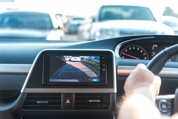 Rear View Monitor for car reverse system. Rear area image showing to driver by video camera at rear area. Automotive safety technology equipment.