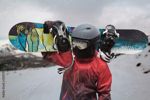 Cuadros en Lienzo  Snowboarder with a board on his shoulders